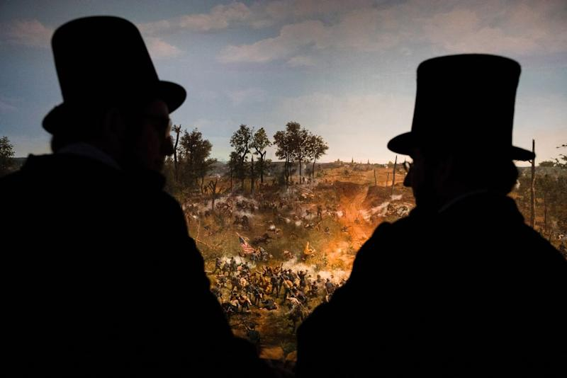 Several Abe Lincolns walk around the Atlanta History Center, where they viewed a restored cyclorama of the 1864 Battle of Atlanta, on April 13. | Benjamin Norman for TIME