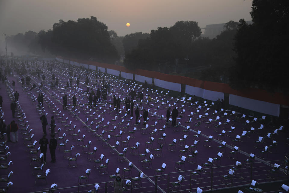 Chair are kept at a mandatory distance as a precaution against the coronavirus at Rajpath for the Republic Day parade in New Delhi, India, Tuesday, Jan. 26, 2021. (AP Photo/Manish Swarup)