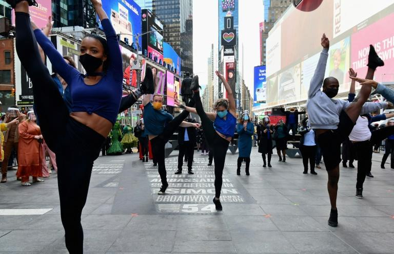 "Performers participate in a live pop-up event commemorating Broadway's ""lost year"" at Time Square on March 12, 2021"