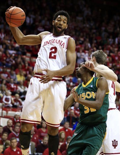 Indiana's Christian Watford grabs a rebound from North Dakota State's TrayVonn Wright during the first half of an NCAA college basketball game, Monday, Nov. 12, 2012, in Bloomington, Ind. (AP Photo/Darron Cummings)