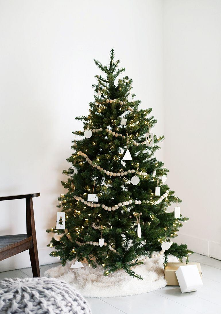 "<p>Care to make a tree come to life with just two elements? Follow <a href=""http://themerrythought.com/diy/minimal-christmas-tree/"" rel=""nofollow noopener"" target=""_blank"" data-ylk=""slk:The Merrythought's"" class=""link rapid-noclick-resp"">The Merrythought's</a> lead and adorn your Christmas tree with a wood garland and clay ornaments—natural elements that lend holiday decor a soothing, relaxed aesthetic. </p>"