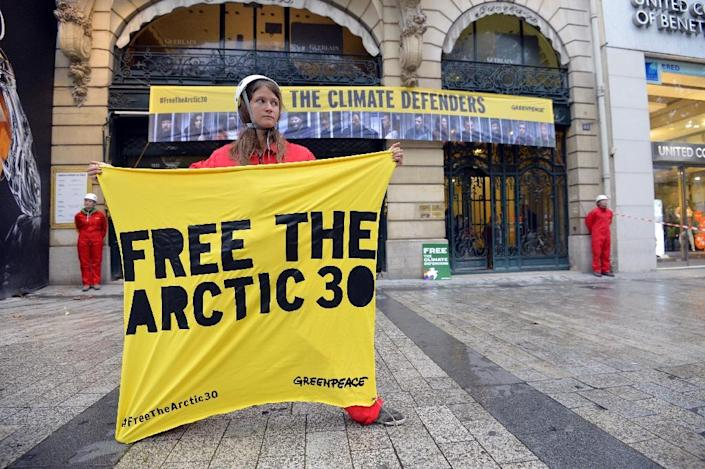 Greenpeace activists stand in front of the Paris headquarters of the Russian company Gazprom on October 9, 2013, to demand the release of the 30 crew members of the Arctic Sunrise icebreaker imprisoned in Russia since the end of September (AFP Photo/Miguel Medina)