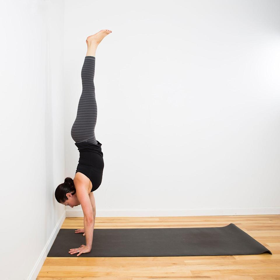 """<p>Handstand holds against a wall are one of <a href=""""http://postpartumtrainer.com/"""" class=""""link rapid-noclick-resp"""" rel=""""nofollow noopener"""" target=""""_blank"""" data-ylk=""""slk:ob-gyn"""">ob-gyn</a> and NASM-certified personal trainer Brittany Robles's favorite isometric exercises. She told POPSUGAR she's a fan of these because they're """"great at developing shoulder and tricep strength."""" <a href=""""https://www.popsugar.com/fitness/Learn-How-Do-Handstand-7676437"""" class=""""link rapid-noclick-resp"""" rel=""""nofollow noopener"""" target=""""_blank"""" data-ylk=""""slk:Here are nine moves for learning how to do a complete handstand"""">Here are nine moves for learning how to do a complete handstand</a>, but Dr. Robles said you can also practice holding yourself up in a <a href=""""https://www.popsugar.com/fitness/How-Do-Ball-Pike-Rollback-46204972"""" class=""""link rapid-noclick-resp"""" rel=""""nofollow noopener"""" target=""""_blank"""" data-ylk=""""slk:piked push-up position"""">piked push-up position</a> with your feet on the floor or elevated on a surface.</p> <ul> <li>Place your hands approximately six inches away from the edge of a wall.</li> <li>Kick your feet up, press the top of your head against the wall, and move your legs away from the wall. This will get your body in the correct alignment with your hips and shoulders stacked.</li> <li>Squeeze your legs together, and keep your core engaged.</li> <li>If you can't hold your legs away from the wall, use the wall as support with your back and lower body against it (you'll have to move closer to the wall with your hands).</li> <li>Dr. Robles suggests holding a handstand for 15 seconds. As you get stronger, increase the amount of time you hold your handstand.</li> </ul>"""