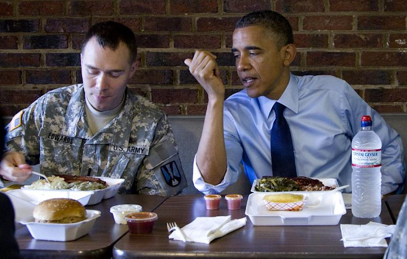 President Barack Obama Army First Lt. William Edwards, a 2012 Military Fatherhood Award Winner, Wednesday, June 13, 2012, during a visits Kenny's BBQ restaurant in Washington. (AP Photo/Carolyn Kaster)