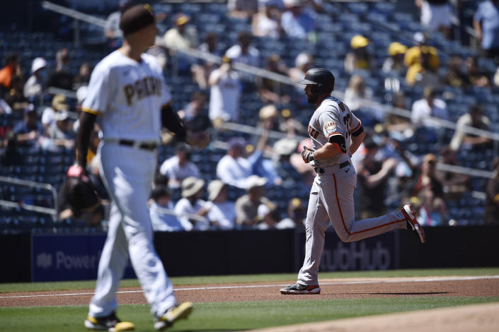 San Francisco Giants' Darin Ruf, right, rounds the bases after hitting a two-run home run off of San Diego Padres starting pitcher Blake Snell during the second inning of a baseball game in San Diego, Wednesday, April 7, 2021. (AP Photo/Kelvin Kuo)