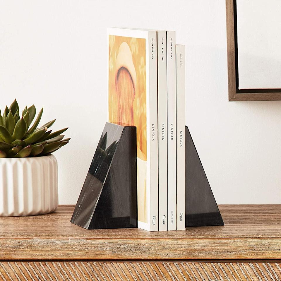 <p>Keep your favorite books in these <span>Fox Run Triangular Polished Black Marble Bookends</span> ($50).</p>