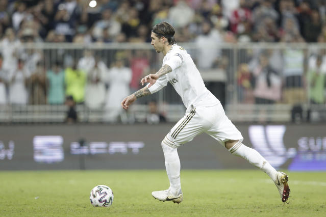 Real Madrid's Sergio Ramos scores the winning penalty during the Spanish Super Cup Final soccer match between Real Madrid and Atletico Madrid at King Abdullah stadium in Jiddah, Saudi Arabia, Sunday, Jan. 12, 2020. (AP Photo/Hassan Ammar)