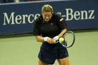 Kim Clijsters, of Belgium, returns a shot to Ekaterina Alexandrova, of Russia, during the first round of the U.S. Open tennis championships, Tuesday, Sept. 1, 2020, in New York. (AP Photo/Frank Franklin II)