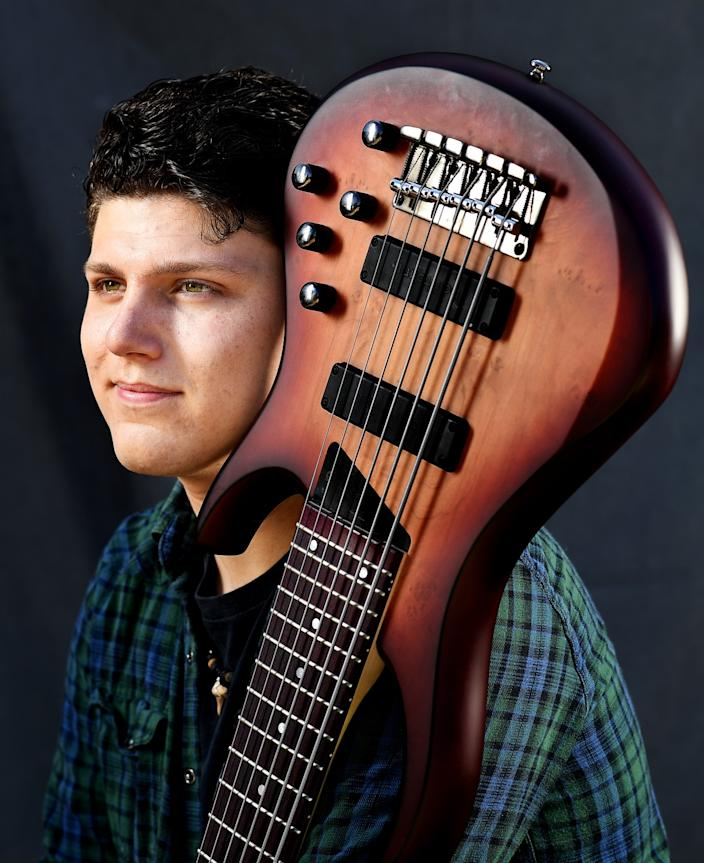 """James Bergren, a bass player who plans to attend Berklee College of Music in Boston this fall, photographed at home in Long Beach. <span class=""""copyright"""">(Christina House/Los Angeles Times)</span>"""