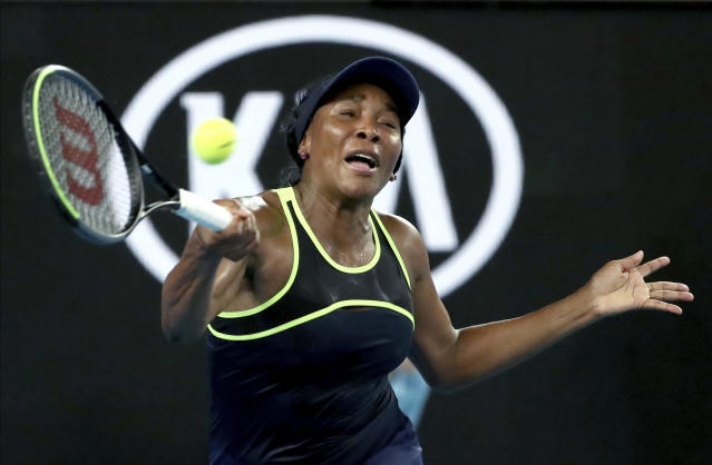 "United States'Venus Williams makes a forehand return to compatriot Cori ""Coco"" Gauff during their first round singles match at the Australian Open tennis championship in Melbourne, Australia, Monday, Jan. 20, 2020. (AP Photo/Dita Alangkara)"