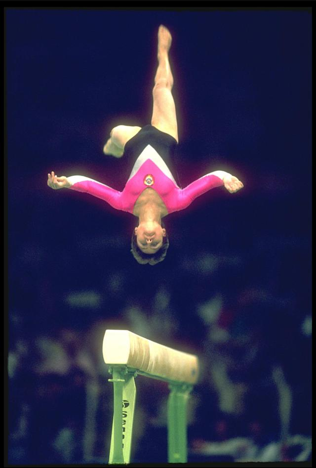23 SEP 1988: YELENA SHUSHUNOVA OF THE SOVIET UNION PERFORMS HER ROUTINE ON THE BALANCE BEAM DURING THE GYMNASTICS COMPETITION AT THE 1988 SEOUL OLYMPICS.