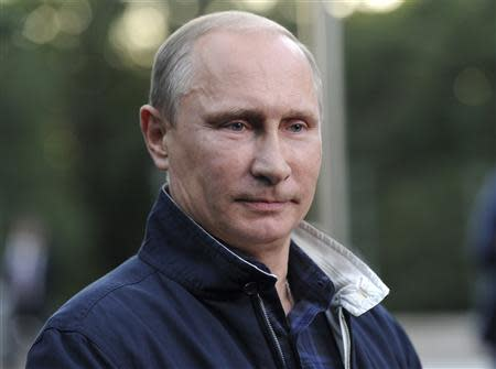 Russia's President Putin looks on during a meeting with journalists in Vladivostok