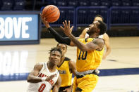 Grambling guard Trevell Cunningham drives past Arizona guard Bennedict Mathurin (0) during the first half of an NCAA college basketball game Friday, Nov. 27, 2020, in Tucson, Ariz. (AP Photo/Rick Scuteri)