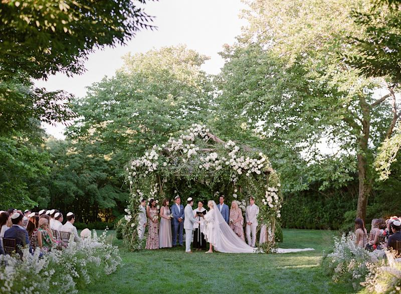 Our chuppah was covered in overgrown ivy and garden roses.