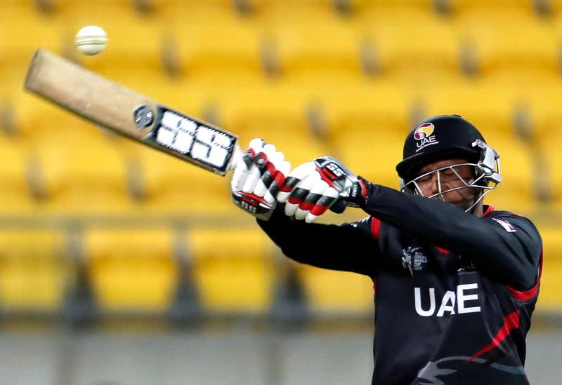 FILE PHOTO: United Arab Emirates' Mohammad Naveed hits out against South Africa during their Cricket World Cup match in Wellington