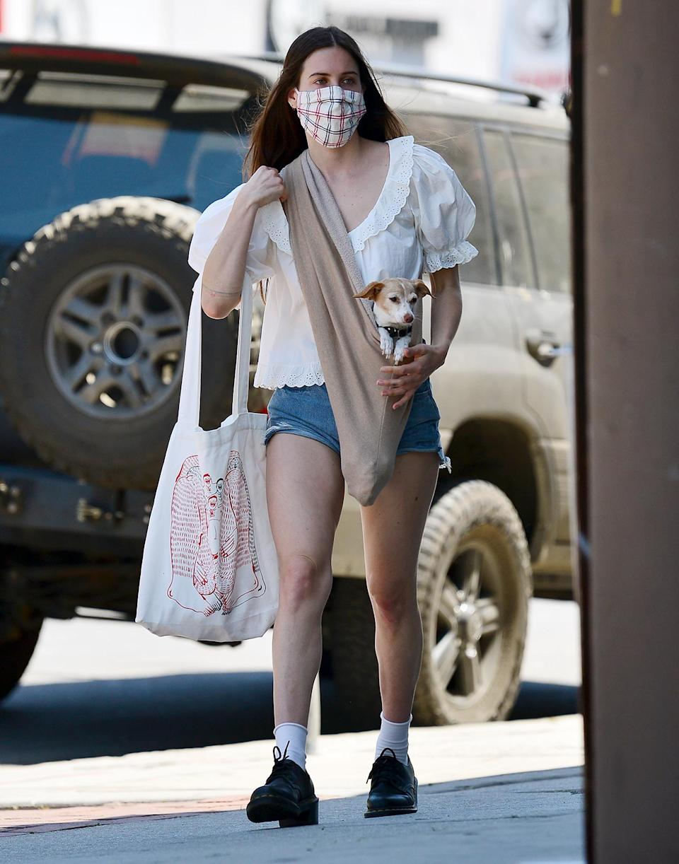 <p>Scout Willis takes her rescue puppy out in a sling pouch to go shopping in L.A. on Tuesday.</p>