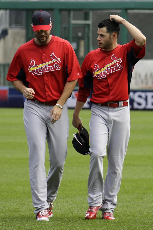 St. Louis Cardinals pitcher Joe Kelly, right, talks with pitcher Adam Wainwright while warming up in the outfield during a baseball workout in Pittsburgh, Saturday, Oct. 5, 2013. Kelly is scheduled to start Game 3 of the National League division series against the Pittsburgh Pirates on Sunday. (AP Photo/Gene J. Puskar)