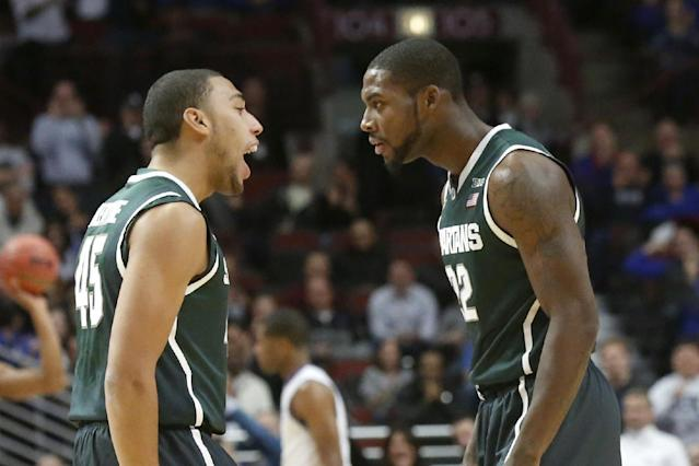Michigan State guard Denzel Valentine (45) talks to Branden Dawson after Michigan State started with a 10-0 run against Kentucky during an NCAA college basketball game Tuesday, Nov. 12, 2013, in Chicago. (AP Photo/Charles Rex Arbogast)