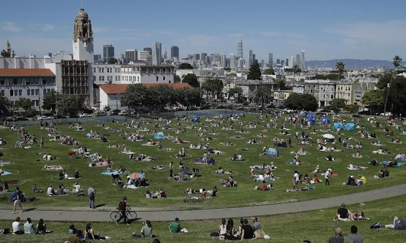 Visitors set up inside circles designed to help prevent the spread of the coronavirus by encouraging social distancing at Dolores Park in San Francisco in May 2020 (AP Photo/Jeff Chiu, File)