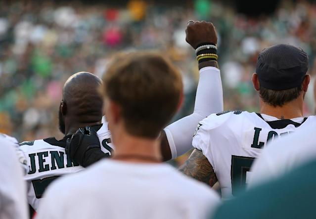 Malcolm Jenkins #27 of the Philadelphia Eagles raises his fist during the national anthem as Chris Long #56 puts his arm around him prior to the preseason game against the Pittsburgh Steelers (AFP Photo/Mitchell Leff)