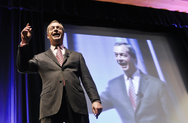 The UK Independence Party leader, Nigel Farage, delivers a speech on stage at the UKIP Spring Conference 2014 held at the Riviera International Conference Centre, Torquay, England, Saturday March 1, 2014. The UK Independence Party claims its support is growing throughout Britain ahead of European Parliament elections in May. The upstart party led by Nigel Farage hopes to capitalize on anti-European Union and anti-immigrant sentiments. At public meetings at the end of its two-day conference in southwest England Saturday, Farage said UKIP is winning voters tired of the political elite. (AP Photo/PA, Ben Birchall) UNITED KINGDOM OUT NO SALES NO ARCHIVE
