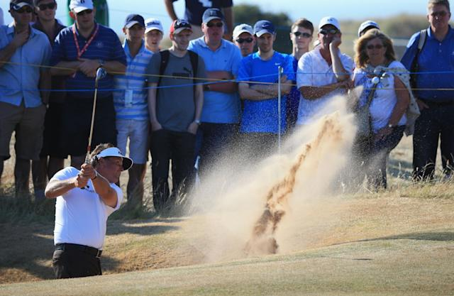 GULLANE, SCOTLAND - JULY 19: Phil Mickelson of the United States hits out of a bunker on the 13th hole during the second round of the 142nd Open Championship at Muirfield on July 19, 2013 in Gullane, Scotland. (Photo by Matthew Lewis/Getty Images)