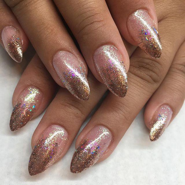 """<p>By using an ombre effect, concentrating the glitter at the tip of your nail and fading it down you too can have nails like these.</p><p><a href=""""https://www.instagram.com/p/Bm40GwhAGY6/"""" rel=""""nofollow noopener"""" target=""""_blank"""" data-ylk=""""slk:See the original post on Instagram"""" class=""""link rapid-noclick-resp"""">See the original post on Instagram</a></p>"""