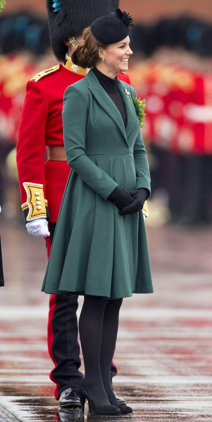 <p>Kate Middleton announced her first pregnancy earlier than most royal mothers, as she had to check into the hospital for acute morning sickness. While attending one of her first public engagements after the announcement, the Duchess of Cambridge wore a flared A-line coat dress with a slightly-heightened waistline that hinted at a growing bump. </p>