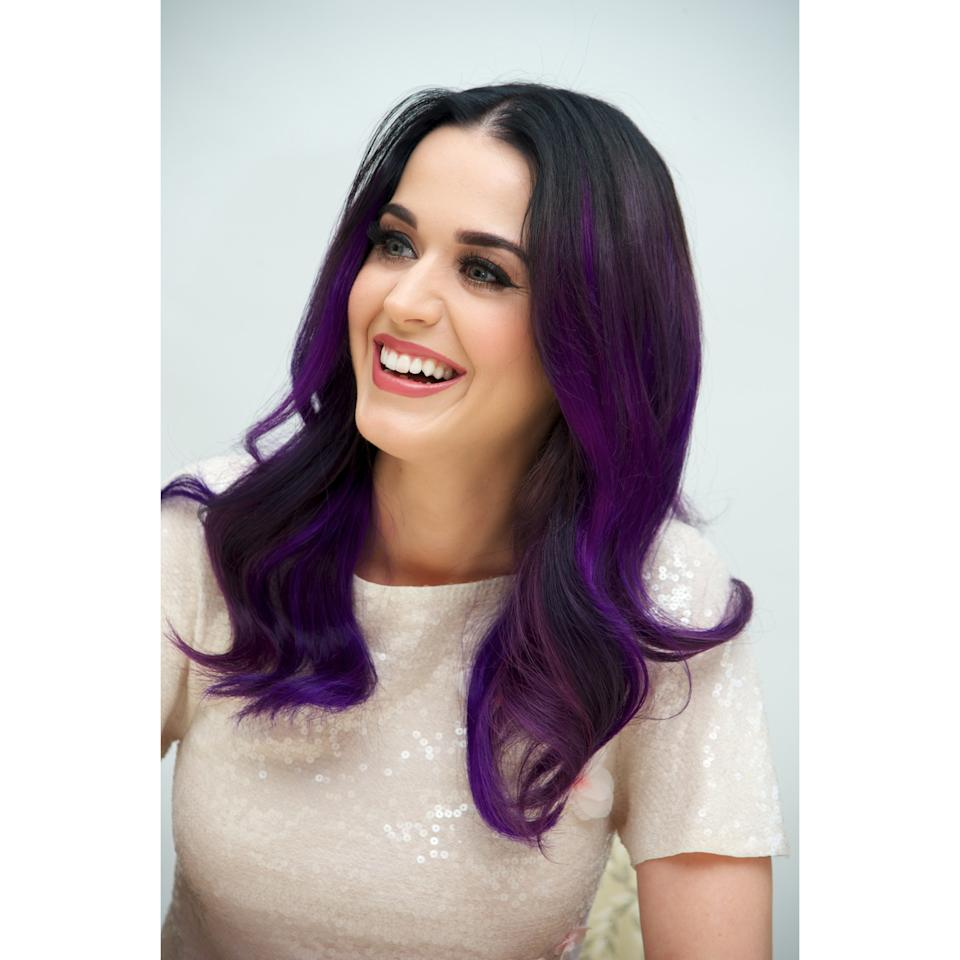 <p>The pop star isn't afraid of a little Manic Panic — she's had hair every shade of Roy G. Biv — but her take on purple was surprisingly understated. Rather than go for a full wash of color, the regal shade was painted in thick chunks from just below her roots.</p>