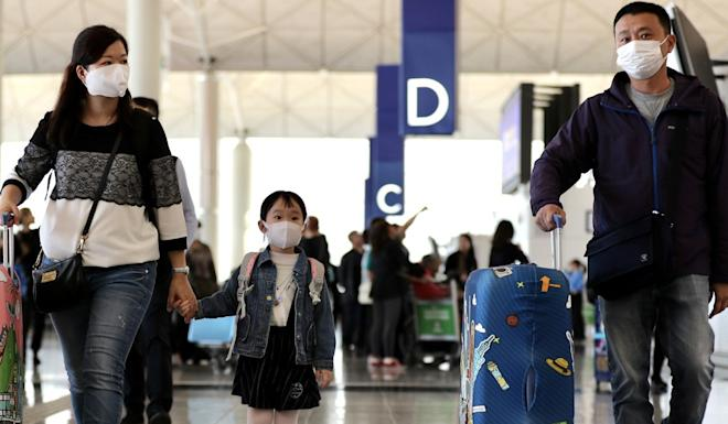 Politicians want the Hong Kong government to consider tougher measures to restrict travellers from regions with virus outbreak from entering the city. Photo: Bloomberg