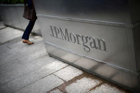 A man walks into the JP Morgan headquarters at Canary Wharf in London