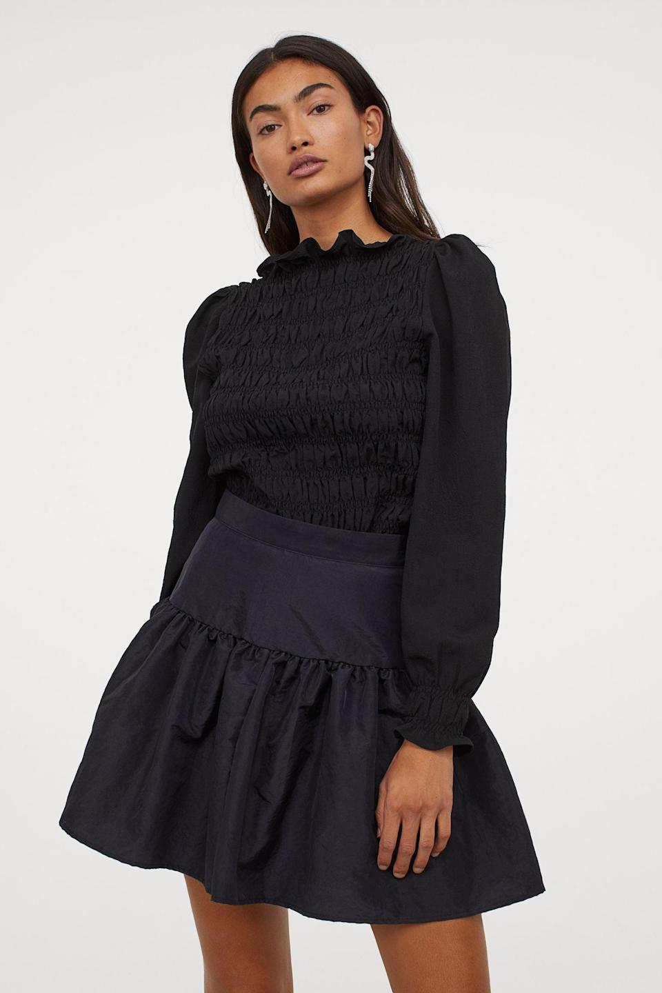 <p>I love the length of this <span>Taffeta Skirt</span> ($25). It's just short enough to show off your legs in a tasteful way.</p>