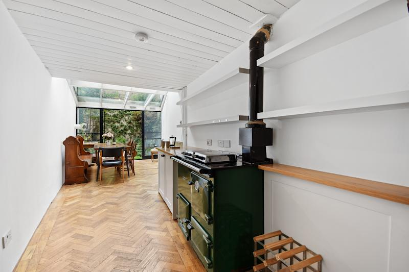 The kitchen has an Aga which fuels the central heating. (Winkworth)