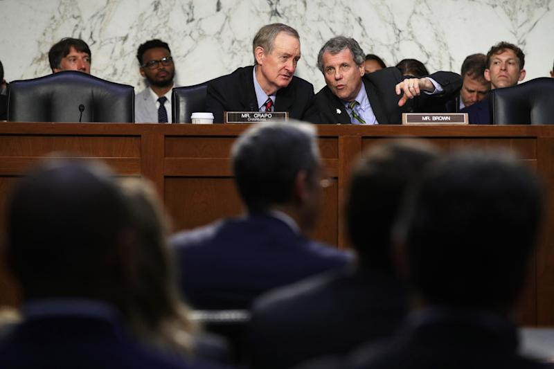 "WASHINGTON, DC - JULY 16: Committee chairman Sen. Mike Crapo (R-ID) (L) listens to ranking member Sen. Sherrod Brown (D-OH) (R) during a hearing before Senate Banking, Housing and Urban Affairs Committee July 16, 2019 on Capitol Hill in Washington, DC. The committee held the hearing on ""Examining Facebook's Proposed Digital Currency and Data Privacy Considerations."" (Photo by Alex Wong/Getty Images)"