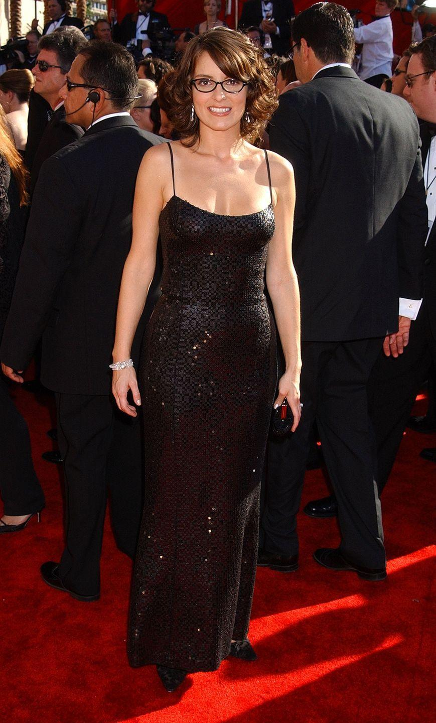 <p>Fey wore a sexy LBD and her signature glasses to the Emmy Awards in 2002. </p>