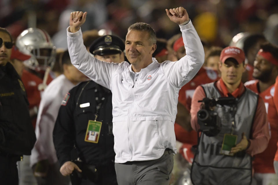 Ohio State coach Urban Meyer celebrates at the end of the team's 28-23 win over Washington at the Rose Bowl. (AP)