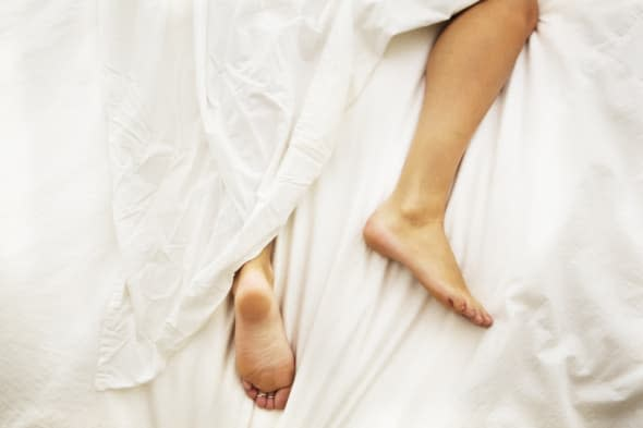 A woman's legs wrapped in a sheet