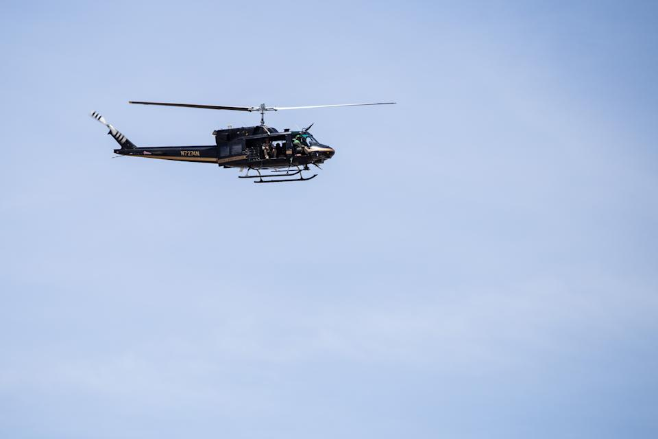 A Customs and Border Protection helicopter flies over the scene of a shooting that occurred at a Wal-Mart near Cielo Vista Mall in El Paso, Texas, Saturday, Aug. 3, 2019. (Photo: Joel Angel Juarez/AFP/Getty Images)