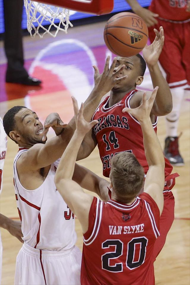 Nebraska's Walter Pitchford, left, competes for a rebound against Arkansas State's Kirk Van Slyke (20) and Kelvin Downs (14) in the first half of an NCAA college basketball game in Lincoln, Neb., Saturday, Dec. 14, 2013. (AP Photo/Nati Harnik)