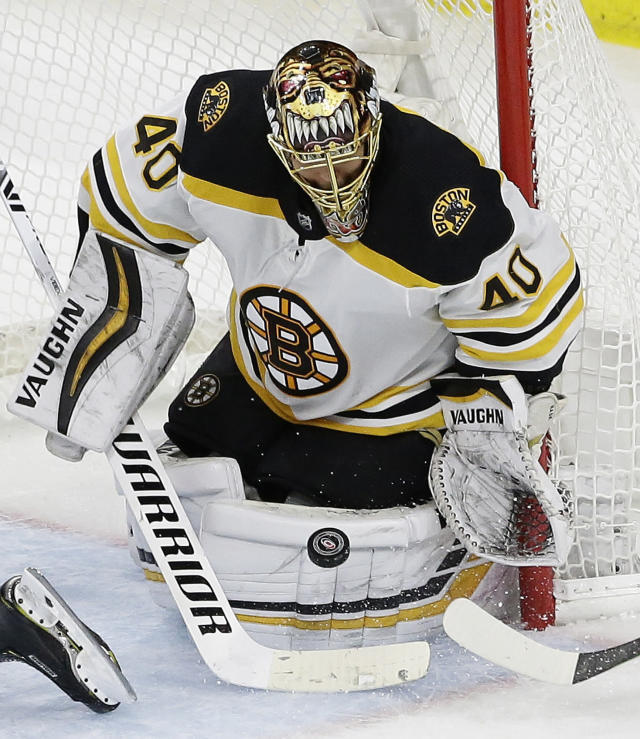 Boston Bruins goalie Tuukka Rask (40), of Finland, blocks a shot on goal during the third period in Game 3 of the NHL hockey Stanley Cup Eastern Conference final series against the Carolina Hurricanes in Raleigh, N.C., Tuesday, May 14, 2019. Boston won 2-1. (AP Photo/Gerry Broome)