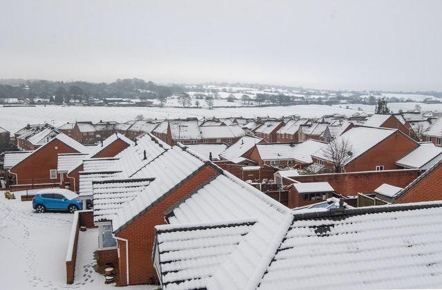 Snow covered rooftops in Hulme, Staffordshire