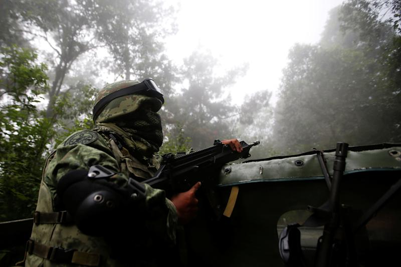 Soldiers patrol the area of Pueblo Viejo in the Sierra Madre del Sur