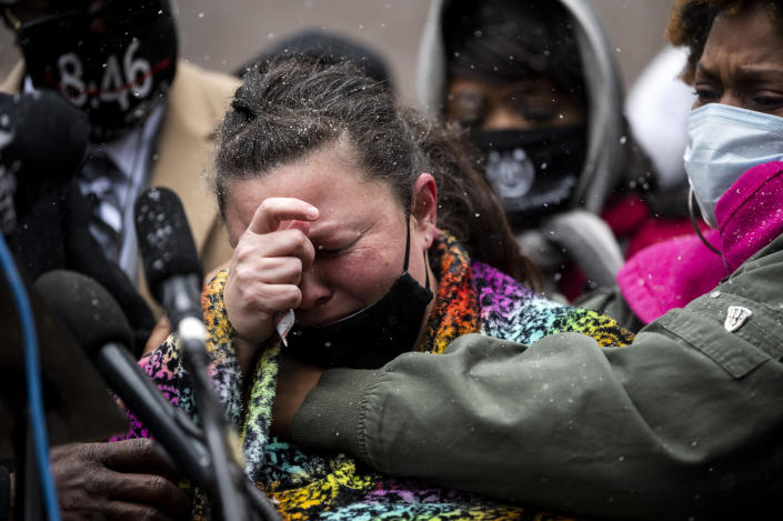Naisha Wright (R) embraces Katie Wright (C), the mother of Daunte Wright, as she speaks during a press conference outside the Hennepin County Government Center on April 13, 2021 in Minneapolis, Minnesota. (Stephen Maturen/Getty Images)