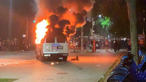PHOTO: In this photo provided by Khadijah, flames erupt from a New York City Police Department van set ablaze, Friday, May 29, 2020, in the Brooklyn borough of New York, during a protest of the death of George Floyd in police custody in Minneapolis. (Khadijah/AP)