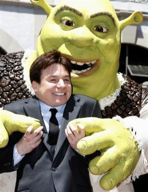 Mike Myers poses with character 'Shrek' as it receives a star on the Hollywood Walk of Fame in Hollywood May 20, 2010.