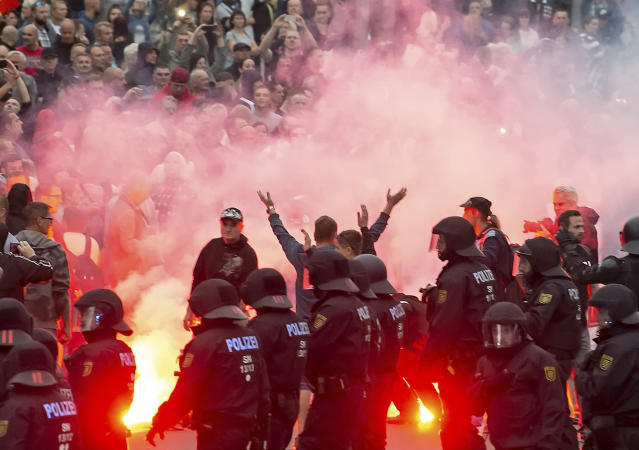 """<p>Protesters light fireworks during a far-right demonstration in Chemnitz, Germany, Monday, Aug. 27, 2018 after a man has died and two others were injured in an altercation between several people of """"various nationalities"""" in the eastern German city of Chemnitz on Sunday. (Photo: Jens Meyer/AP) </p>"""