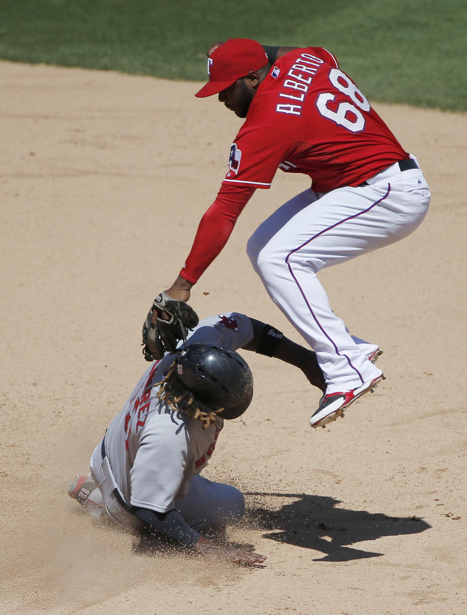 Texas Rangers Hanser Alberto (68) is unable to make the tag in time as Boston Red Sox Hanley Ramirez steals second during the sixth inning of a baseball game, Sunday, May 31, 2015, in Arlington, Texas. (AP Photo/Brandon Wade)