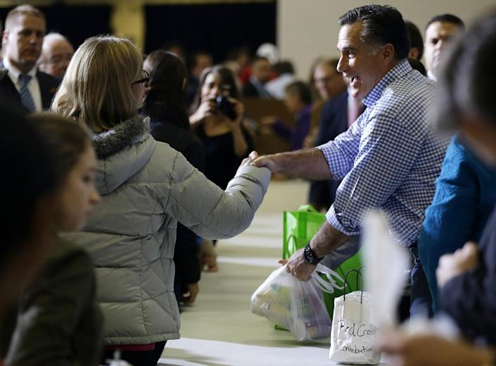 Republican presidential candidate, former Massachusetts Gov. Mitt Romney greets people as he participates in a campaign event collecting supplies from residents and local relief organizations for victims of superstorm Sandy, Tuesday, Oct. 30, 0212, at the James S. Trent Arena in Kettering, Ohio. (AP Photo/Charles Dharapak)