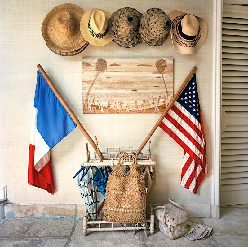 The foyer, where American and French flags nod to the upcoming union of the home's owners.