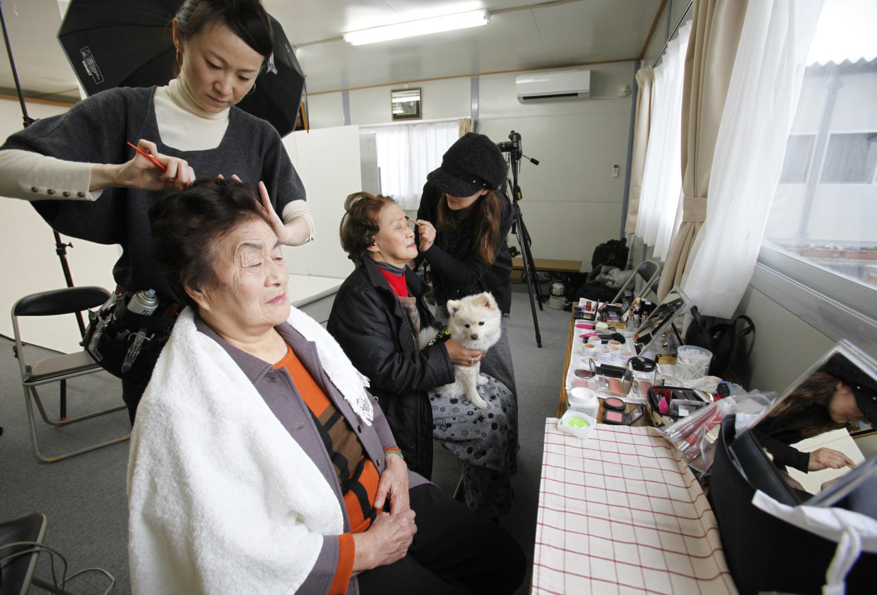 Residents have their hair and make-up done before having their portraits taken for the 3.11 Portrait Project at the Midorigaoka temporary shelter in Koriyama, Fukushima prefecture in the Tohoku region, December 17, 2011. The 3.11 Portrait Project was conceived by photographer Nobuyuki Kobayashi who, with the help of  hair and makeup artists and other volunteers, takes portraits of earthquake survivors in Tohoku, many of whom lost all of their family pictures in the March 11, 2011 disaster. The portraits are then sent to schoolchildren from non-disaster areas, who frame the portraits and send them back to the survivors along with personal messages of support. Picture taken December 17, 2011. REUTERS/Yuriko Nakao